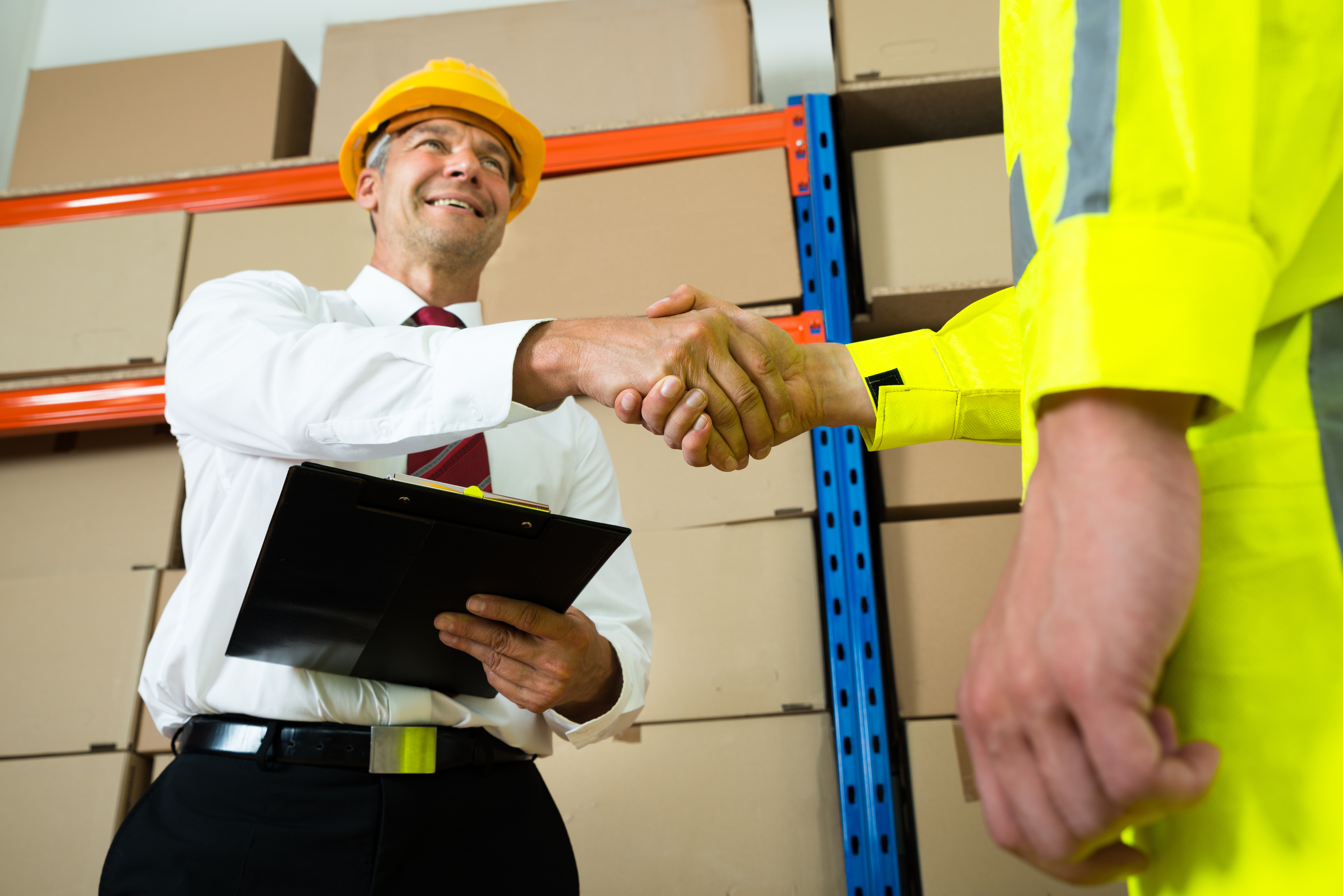 Happy Manager Shaking Hands With Warehouse Worker